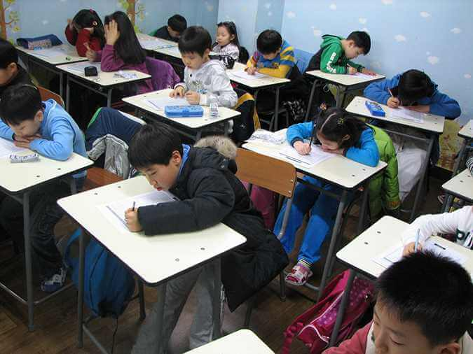 Students taking an exam in school