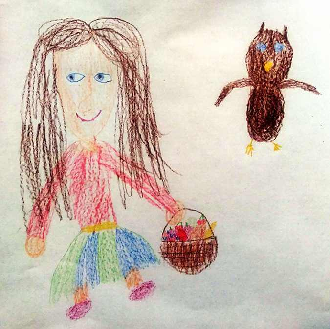 a young person's drawing of a girl and an owl