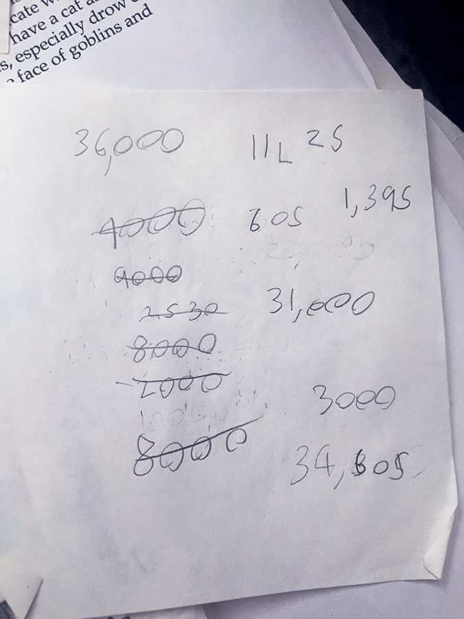 A scrap of paper with math calculations
