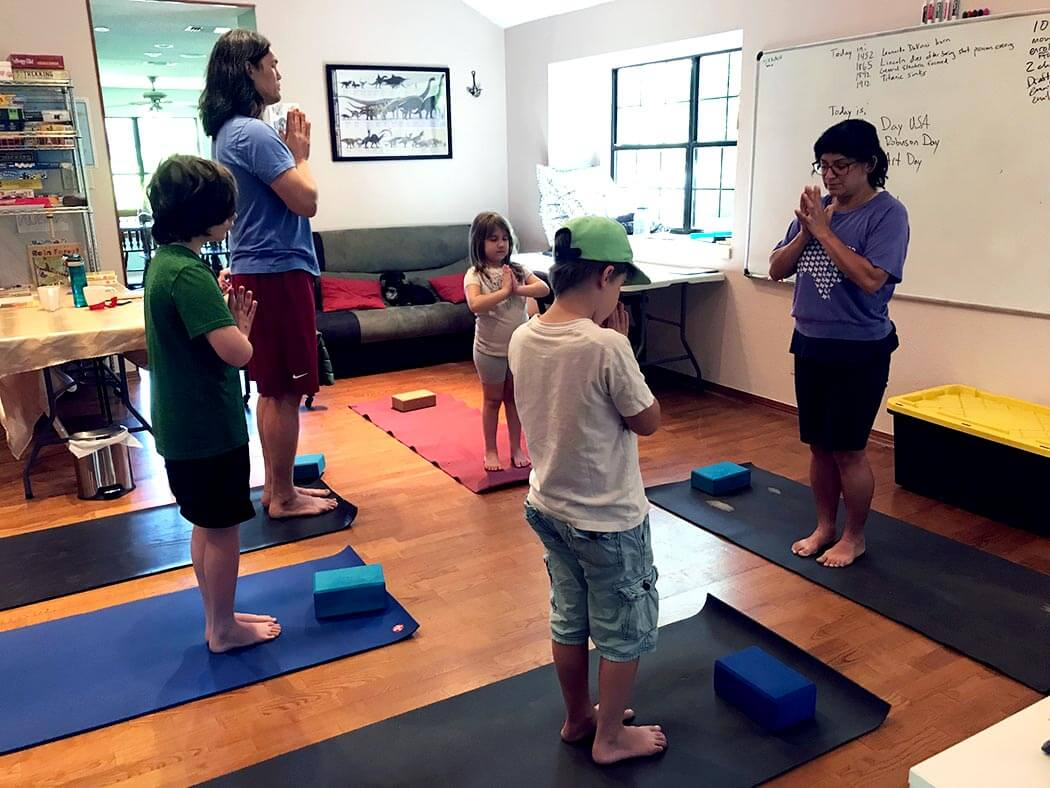 children and adults in a yoga class
