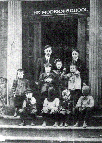 The NYC Modern School, ca. 1911–1912, Principal Will Durant and pupils. This photograph was the cover of the first issue of The Modern School magazine, public domain {{PD-US}}