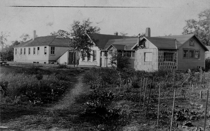 School building and shop (ca.1920), photo by Oscar Stechbardt, courtesy of Special Collections and University Archives, Rutgers University Libraries