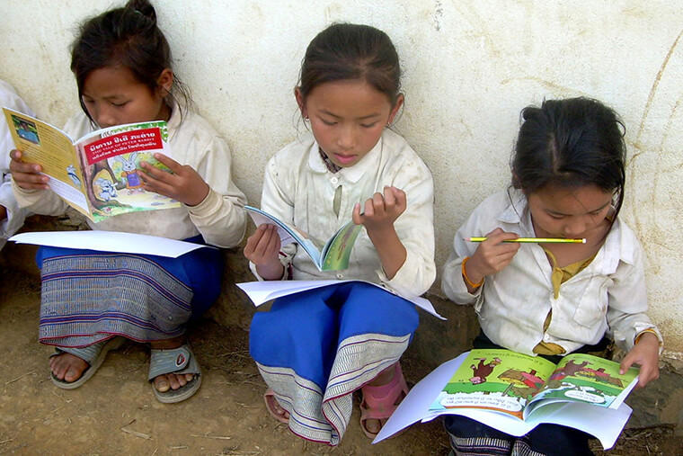 children reading in Laos